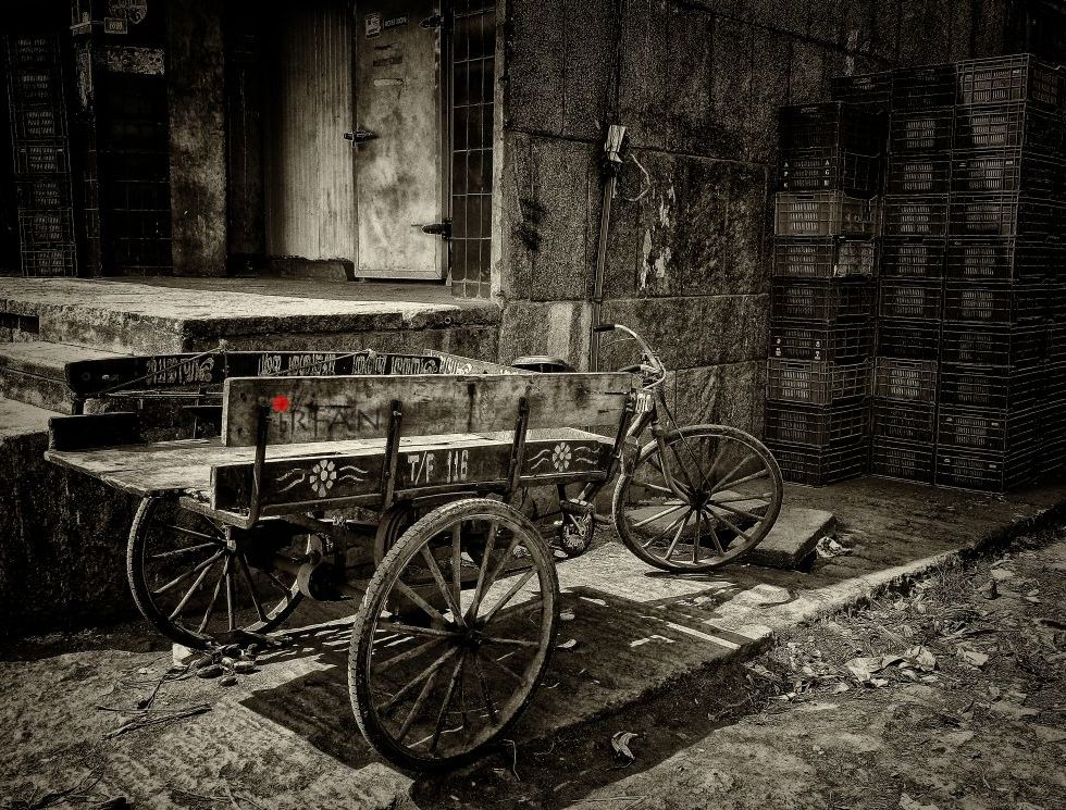 lone cart, black and white, street