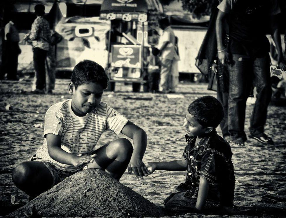 kids playing on beach sand wordpress