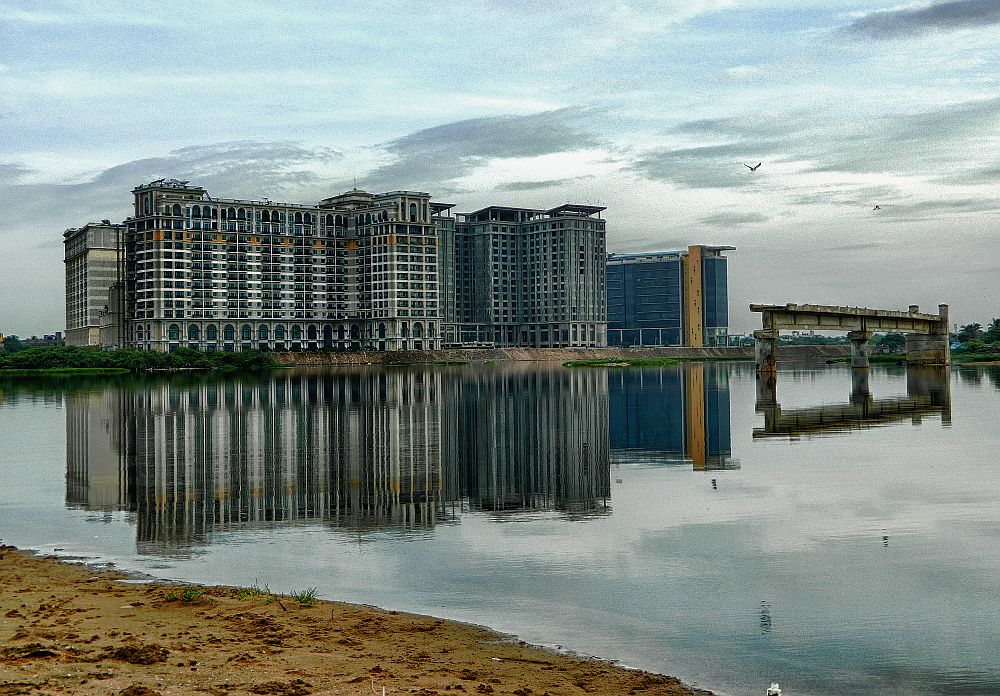 building and bridge reflection broken bridge besant nagar wordpress